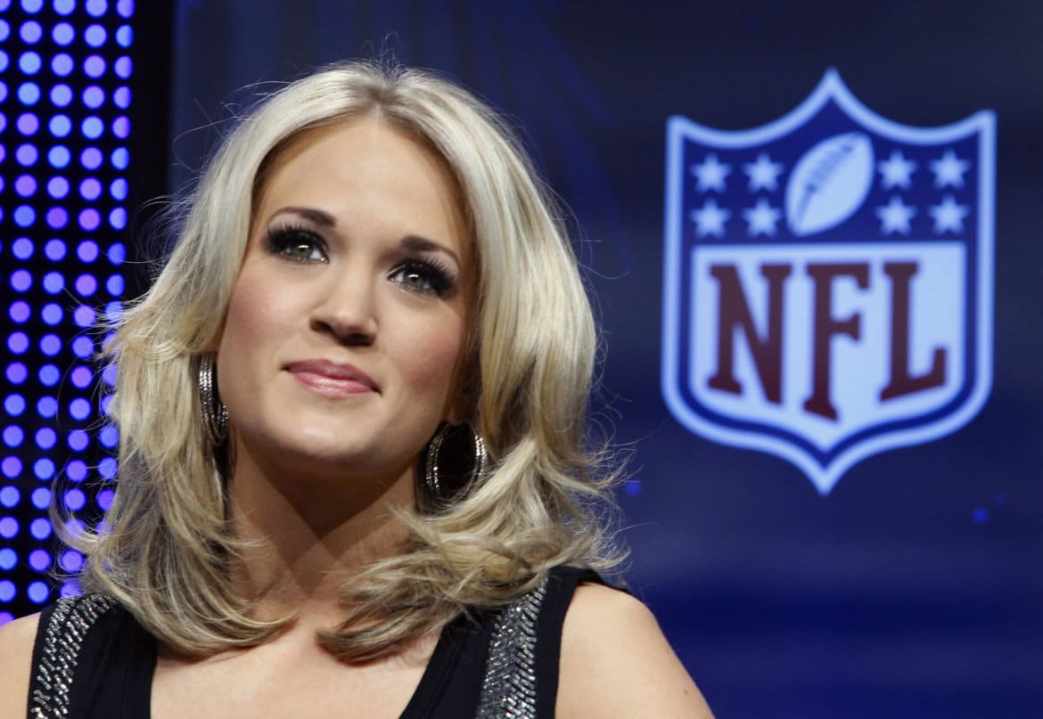 Recording artist Carrie Underwood takes part in a pre-game news conference for the NFL's Super Bowl XLIV football game in Miami, February 4, 2010. The New Orleans Saints will face the Indianapolis Colts in the game on February 7. REUTERS/Brian Snyder (UNITED STATES - Tags: SPORT FOOTBALL ENTERTAINMENT) - RTR29U6D