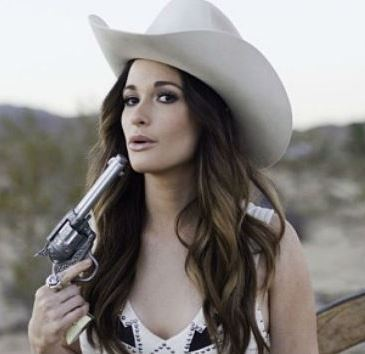 Kacey Musgraves with a gun