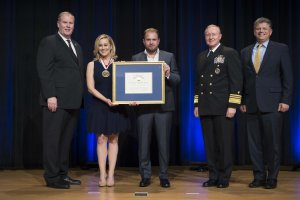 WASHINGTON (Sep. 28, 2016) Deputy Secretary of Defense Bob Work presents the Spirit of Hope Award at the Pentagon, Sep. 28, 2016. (DoD photo by Navy Petty Officer 1st Class Tim D. Godbee) (Released)